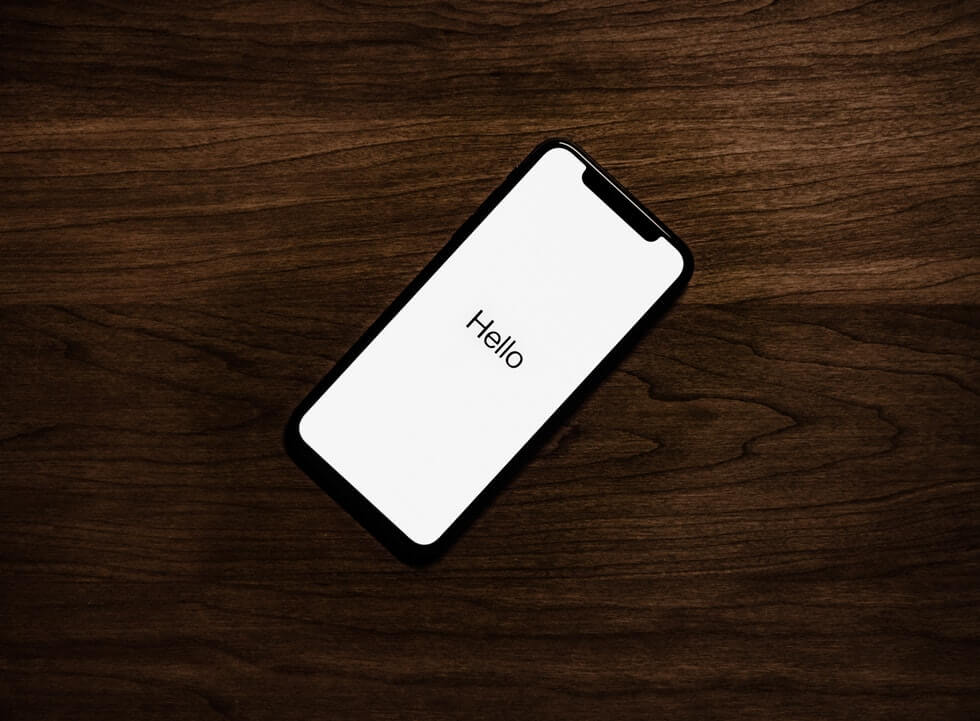 An iphone with the word hello on the screen