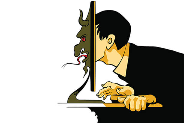An image of a hacker in front of a computer