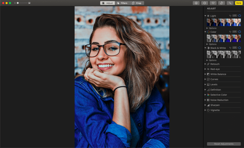 A photo of a woman in Photoshop where the photo is being edited.