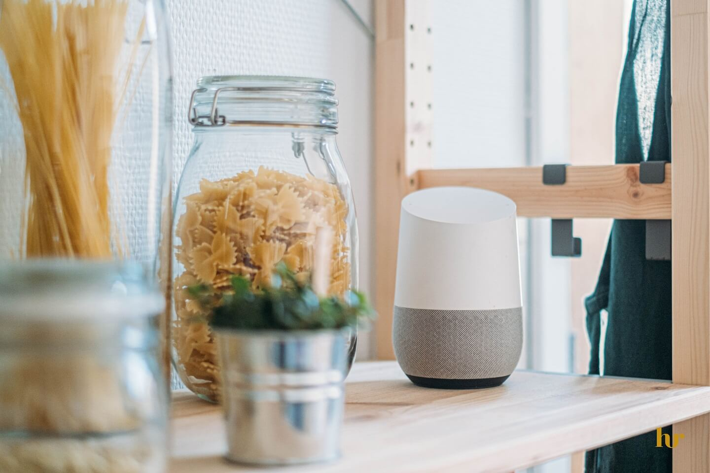 A Google Assistant sitting on a kitchen counter