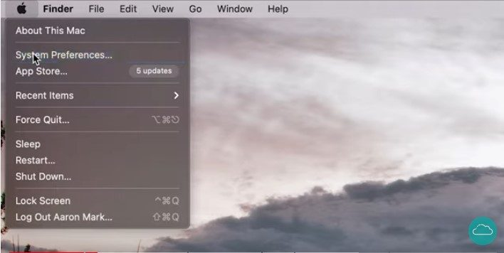 A screenshot of the Mac menu with the mouse cursor on 'System Preferences'.