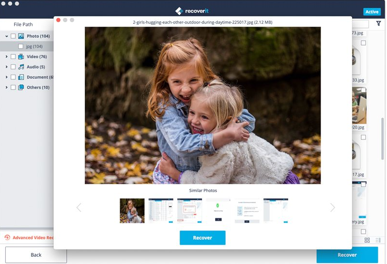 """A screenshot of a recoverd file on Recoverit. A photo of 2 girls hugging outside with the option to hit the """"recover"""" button."""