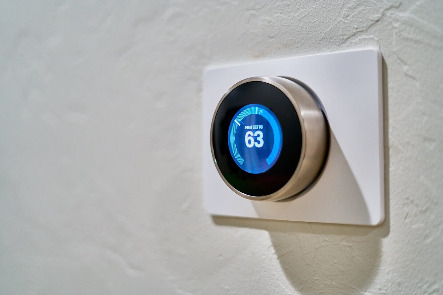 A high quality Nest Learning Thermostat installed and on the wall