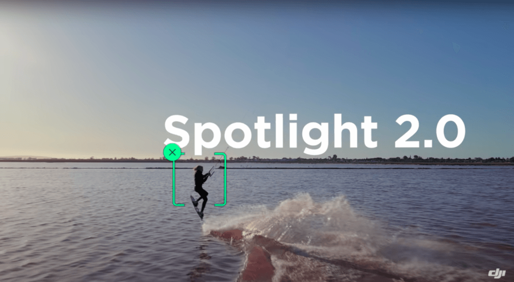 "A kite surfer with the font ""Spotlight 2.0"" on the image."