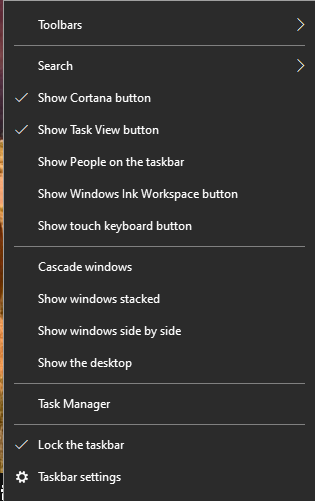 A screenshot of Windows in dark mode and right clicking and opening the menu on the task bar.