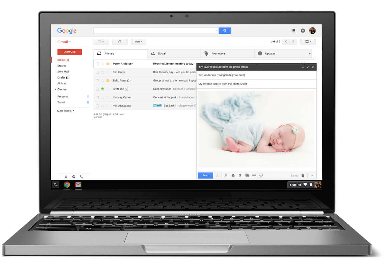 A silver laptop that is opened with Gmail's inbox open on the screen.
