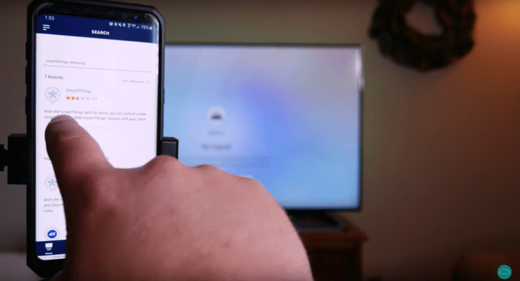 A hand pointing at the steps for connecting the SmartThings app. The hand is pointing to the step on a smartphone.