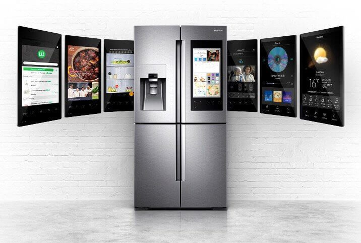 A fridge centered in the photo with two screens on each side