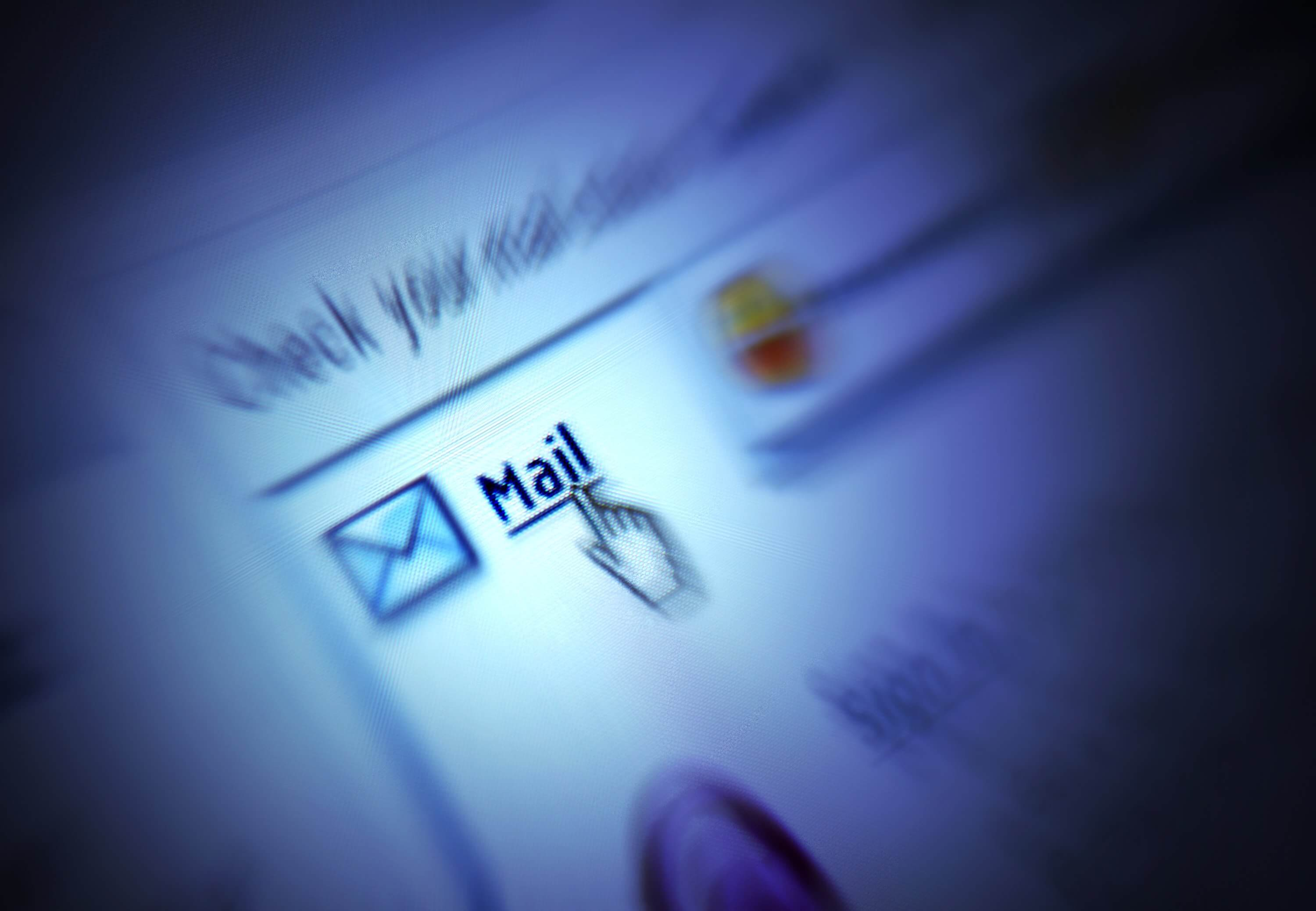 An image with blurred edges and a mouse clicking on Mail to go to an email inbox