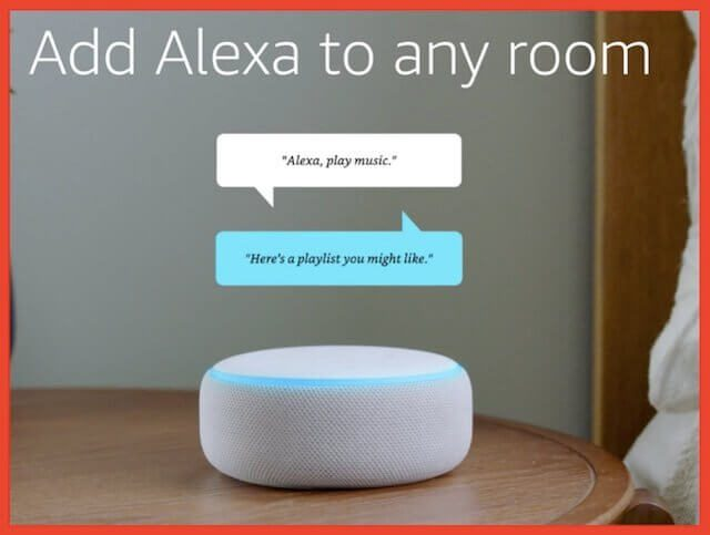 An Amazon Alexa sitting on a brown table