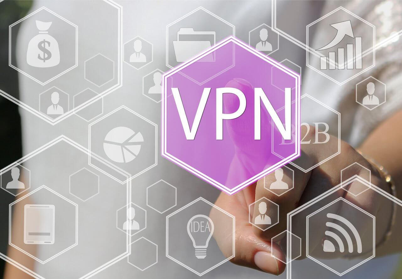 A graphic with a hand in the background pressing a VPN button in the foreground.